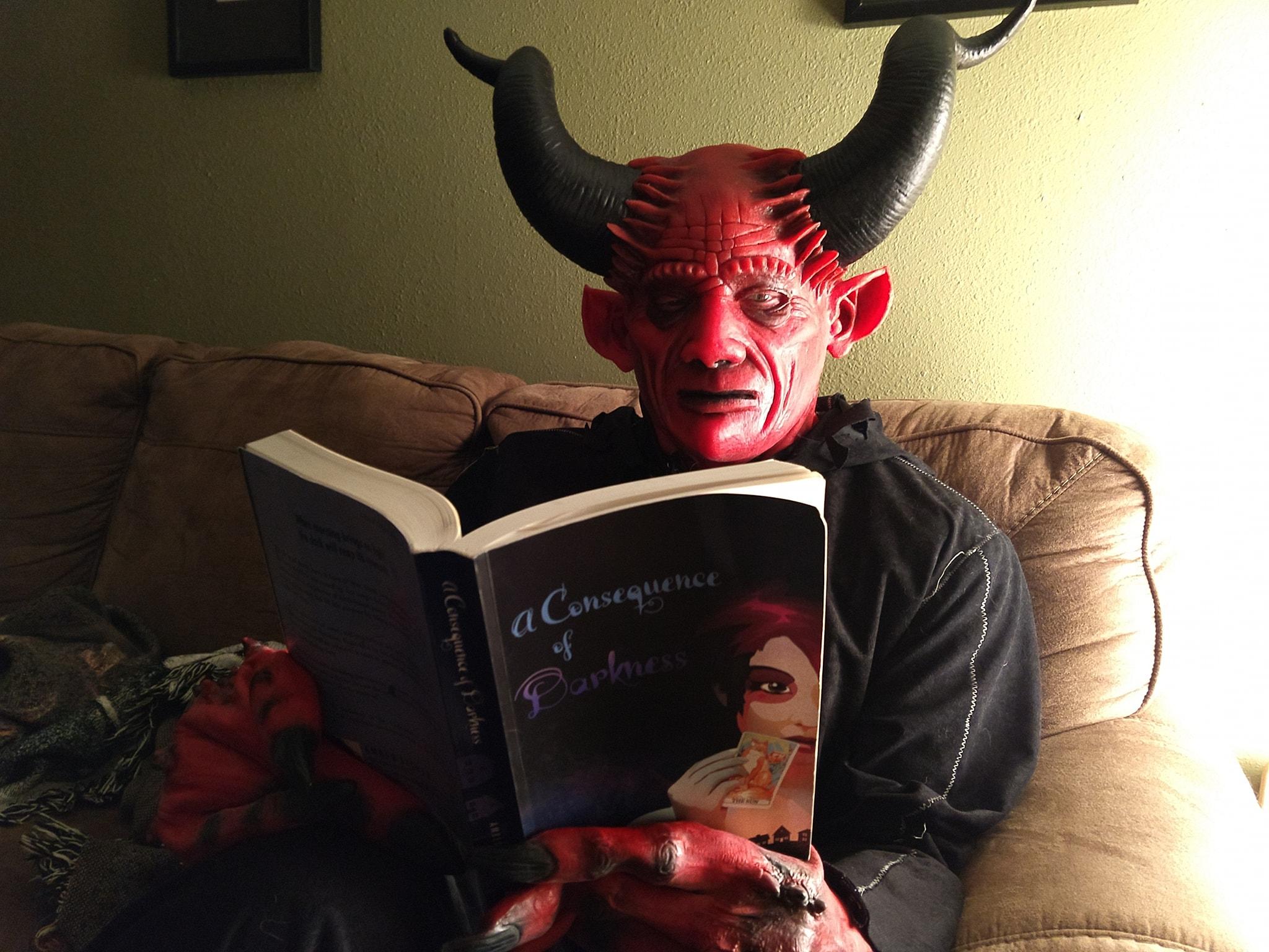 Demon reading a book